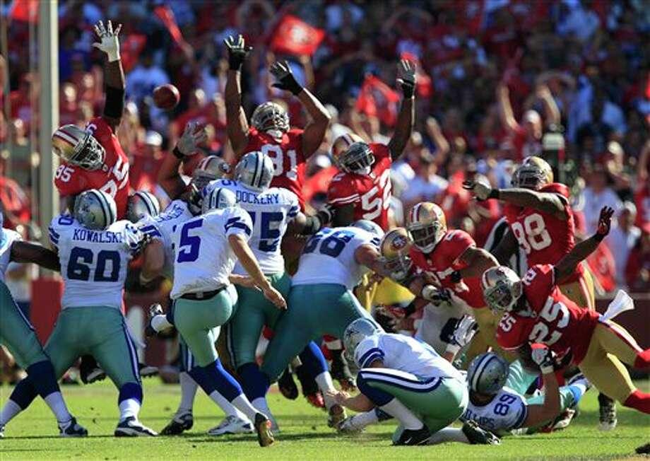 Dallas Cowboys kicker Dan Bailey (5) kicks a 48-yard field goal against the San Francisco 49ers in the fourth quarter of an NFL football game in San Francisco, Sunday, Sept. 18, 2011. (AP Photo/Marcio Jose Sanchez) Photo: Associated Press
