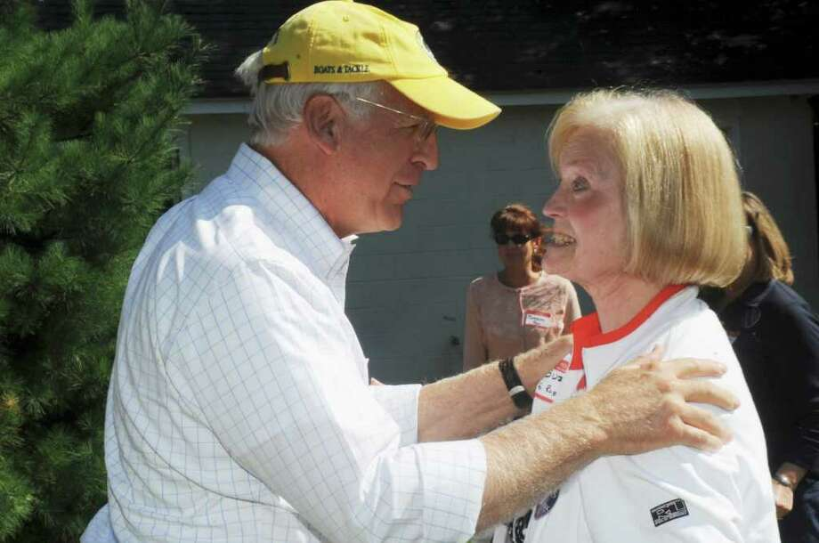 Former U.S. Rep. Christopher Shays, who is considering a run for the U.S. Senate speaks with Suzanne Robbins, of Greenwich, at the Cos Cob Republican Club and Republican Town Committee's 80th annual clambake Sunday, Sept. 18, 2011. Photo: Helen Neafsey / Greenwich Time