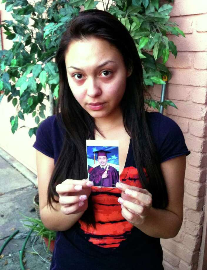 Kristan Gonzalez holds a photo of boyfriend Jose Zamora. She said he recently had been having premonitions and dreams that he would be shot. Photo: Jessica Kwong/jkwong@express-news.net / SAN ANTONIO EXPRESS-NEWS