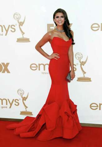 Nina Dobrev arrives at the 63rd Primetime Emmy Awards on Sunday, Sept. 18, 2011 in Los Angeles. Photo: AP