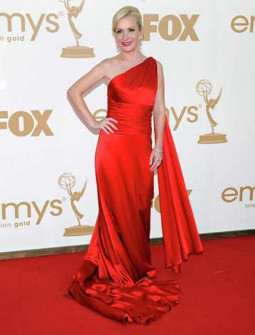 Angela Kinsey arrives at the 63rd Primetime Emmy Awards on Sunday, Sept. 18, 2011 in Los Angeles. Photo: AP