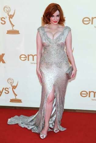 Christina Hendricks arrives at the 63rd Primetime Emmy Awards on Sunday, Sept. 18, 2011 in Los Angeles. Photo: AP