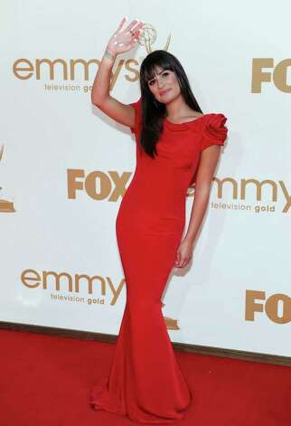 Lea Michele arrives at the 63rd Primetime Emmy Awards on Sunday, Sept. 18, 2011 in Los Angeles. Photo: AP