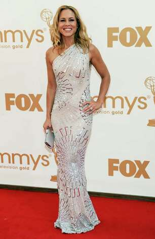 Maria Bello arrives at the 63rd Primetime Emmy Awards on Sunday, Sept. 18, 2011 in Los Angeles. Photo: AP