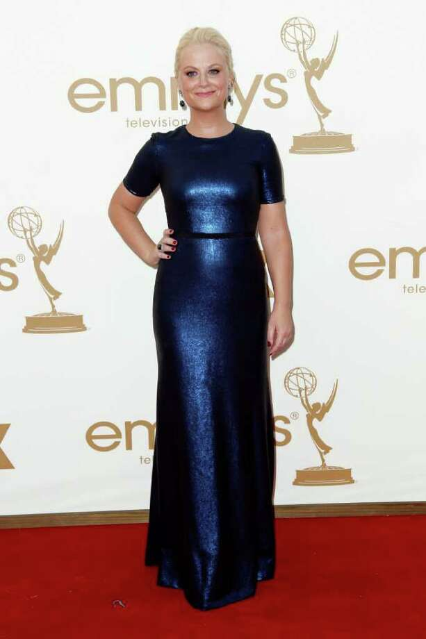 Amy Poehler arrives at the 63rd Primetime Emmy Awards on Sunday, Sept. 18, 2011 in Los Angeles. Photo: AP