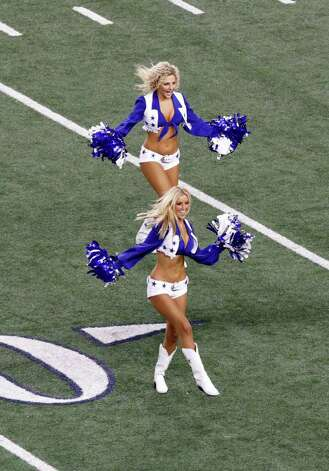 The Dallas Cowboys Cheerleaders perform during the Cowboys' preseason NFL football game against the San Diego Chargers Sunday, Aug. 21, 2011, in Arlington, Texas.  San Diego won the game 20-7. Photo: AP