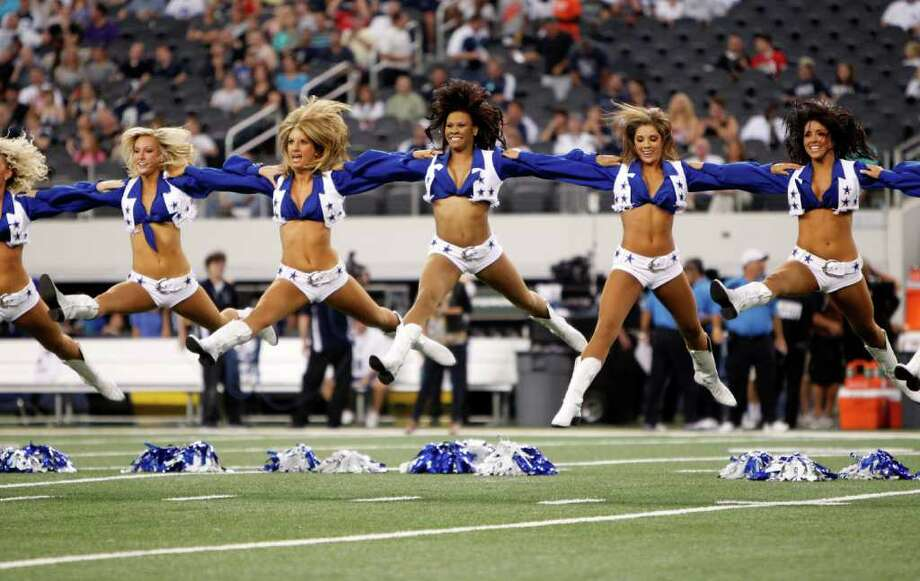 Members of the Dallas Cowboys cheerleaders perform during a preseason NFL football game against the San Diego Chargers Sunday, Aug. 21, 2011, in Arlington, Texas. The Chargers won 20-7. Photo: AP