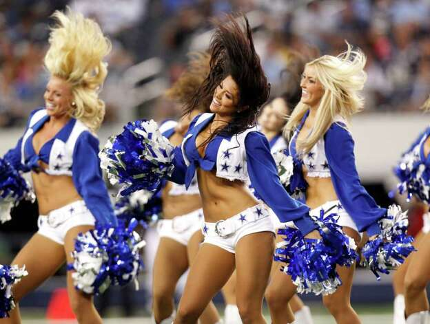 Dallas Cowboys cheerleaders perform during of a preseason NFL football game against the San Diego Chargers Sunday, Aug. 21, 2011, in Arlington, Texas.  San Diego won the game 20-7. Photo: AP