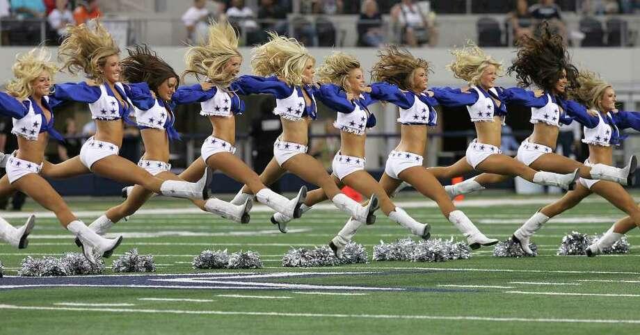 The Dallas Cowboys Cheerleaders perform at the start of the Cowboy's pre-season game against the Denver Broncos at Cowboys Stadium in Arlington, Texas on Thursday, August 11, 2011.  Kin Man Hui/kmhui@express-news.net Photo: KIN MAN HUI, SAN ANTONIO EXPRESS-NEWS / San Antonio Express-News