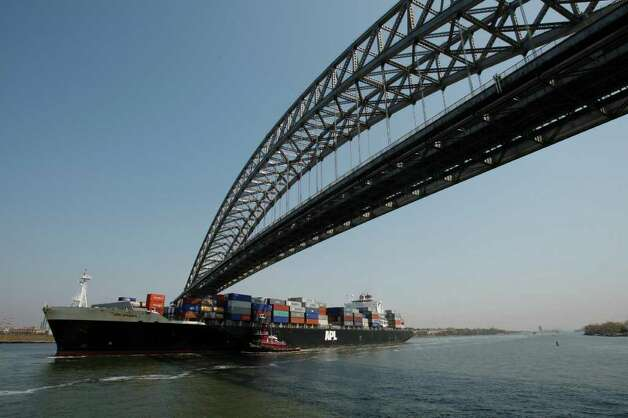 The APL Arabia passes under the Bayonne Bridge.  New container ships, built to utilize the expanded Panama Canal, will not fit under the bridge.  JOHN O'BOYLE/THE STAR-LEDGER Photo: O'Boyle, John, SL / The Star Ledger