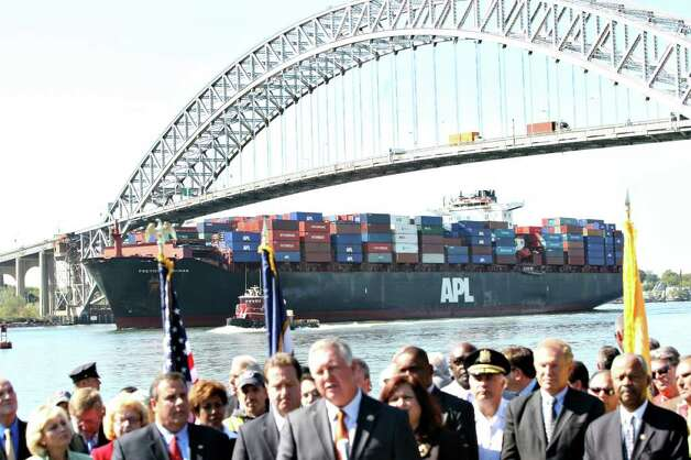 A container ship underway barely clears the Bayonne Bridge as Albio Sires, US Copngressman ;   speaks during a press conference where Governor Chris Christie appeared near the Bayonne Bridge to speak about the billion dollar plan by the Port Authority to address a height clearance problem that threatens to inhibit port commerce in New Jersey. Jerry McCrea/The Star Ledger Photo: McCrea, Jerry, SL / The Star Ledger