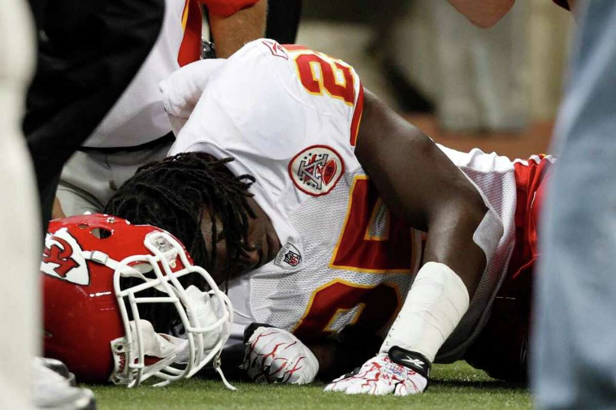 Kansas City Chiefs running back Jamaal Charles (25) on the ground after being injured on a play in the first quarter against the Detroit Lions of an NFL football game in Detroit, Sunday, Sept. 18, 2011. (AP Photo/Rick Osentoski)