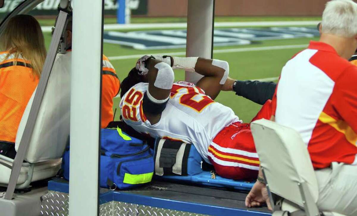 Kansas City Chiefs running back Jamaal Charles covered his face, as he was carted off the field in the first quarter after a knee injury. The Detroit Lions defeated the Kansas City Chiefs, 48-3, Sunday, September 18, 2011 at Ford Field in Detroit, Michigan. (David Eulitt/Kansas City Star/MCT)