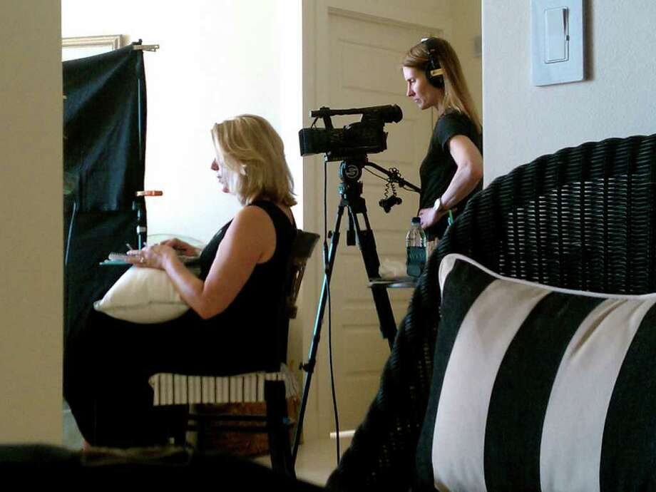 """Megan Smith-Harris, director of """"Trial by Fire: Lives Re-Forged,"""" and Laela Kilbourn, the director of photography for the film, conduct an interview on location in Galveston, Texas. Photo: Contributed Photo"""