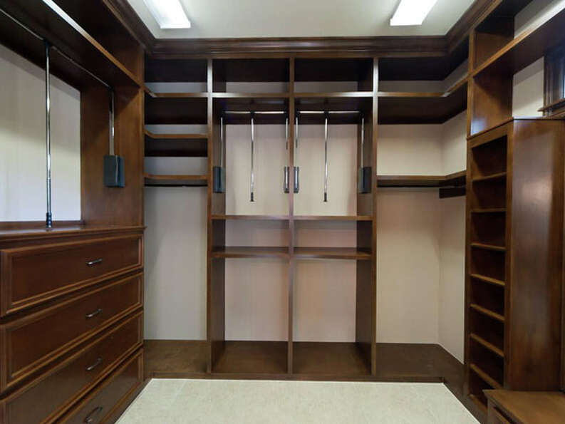 The walk-in closet of the master bedroom allows for easy storage of a huge wardrobe.