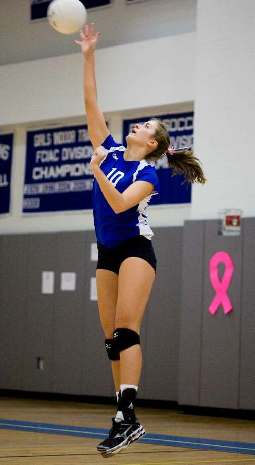 Darien High School's #10 Colby Billhardt serves during a game against Wilton High School in girls volleyball in Darien. Photo: Kerry Sherck / Stamford Advocate