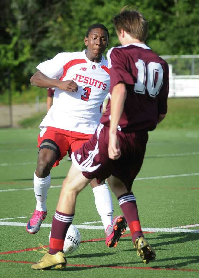 Fairfield Prep's Austin Sims, left, converges on the ball with North Haven's Sam Dunning during their boys soccer matchup at Fairfield University on Monday, September 19, 2011. Photo: Brian A. Pounds / Connecticut Post