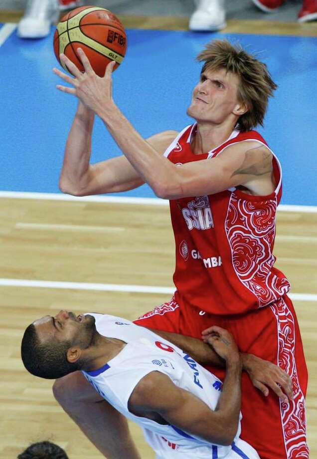 Russia's Andrei Kirilenko, right, collides with France's Tony Parker, left, during the EuroBasket European Basketball Championship semifinal match in Kaunas, Lithuania, Friday, Sept. 16, 2011. France won the match 79-71. Photo: Petr David Josek/Associated Press / AP