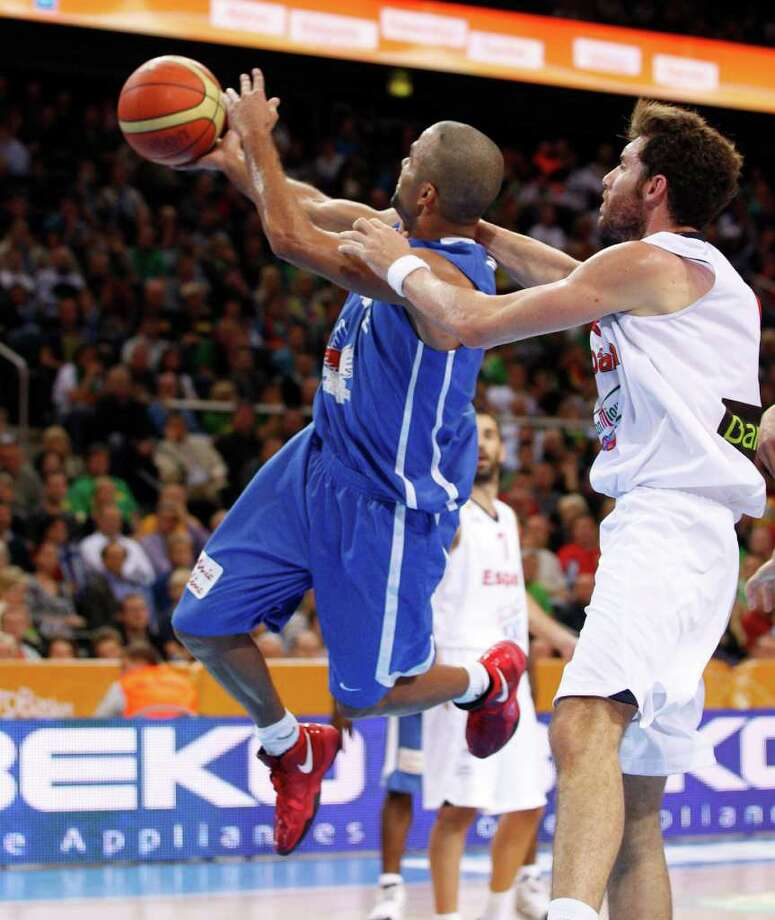 Tony Parker, left, of France is challenged by Rudy Fernandez from Spain during the EuroBasket 2011, European Basketball Championships gold match in Kaunas, Lithuania, Sunday, Sept. 18, 2011. Photo: Mindaugas Kulbis/Associated Press / AP