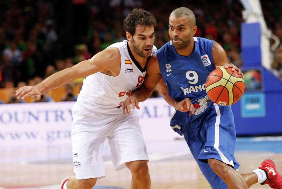 Tony Parker, right, of  France  is challenged by Jose Manuel Calderon, left, from Spain  during the EuroBasket 2011, European Basketball Championships gold  match  in Kaunas, Lithuania, Sunday, Sept. 18, 2011. Photo: Mindaugas Kulbis/Associated Press / AP