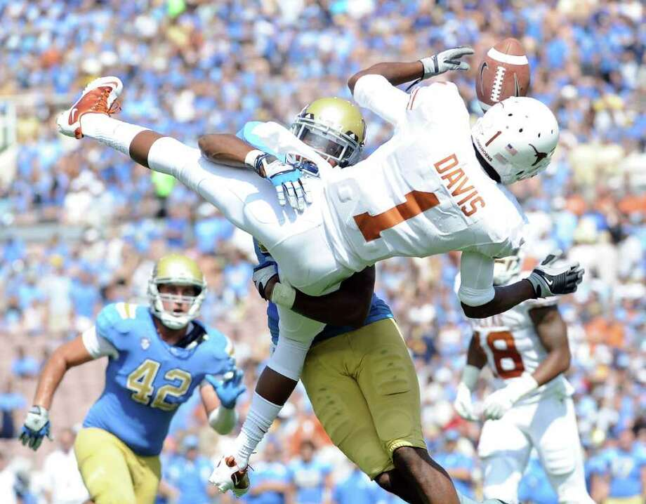 Harry How: Getty Images PAC MEN?: Unlike Saturday's game, in which UCLA's Aaron Hester jolted Texas' Mike Davis, the schools' next meeting could be a conference matchup. Photo: Harry How / 2011 Getty Images
