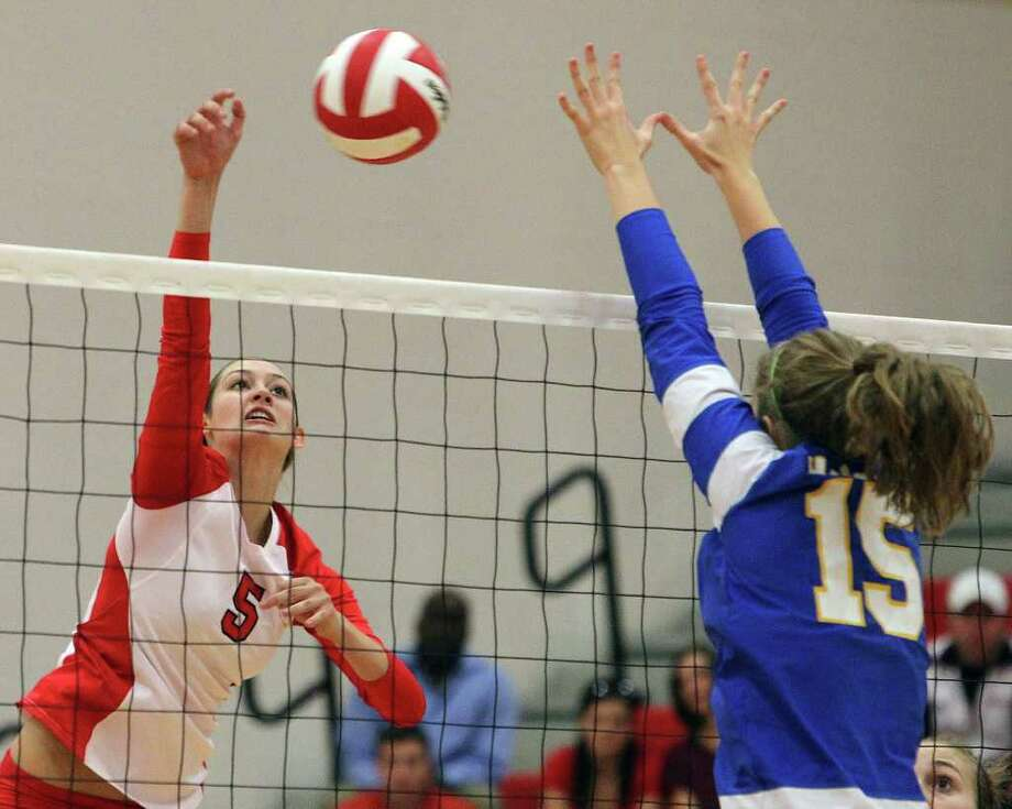 New Braunfels Canyon's Rafae Strobos takes a shot against Alamo Heights' Abbey Strunk (15) last week. Strobos had 19 kills in a victory against Alamo Heights, and 17 kills and 22 digs in a win against Hays during District 27-4A action. Photo: Kin Man Hui/kmhui@express-news.net / SAN ANTONIO EXPRESS-NEWS
