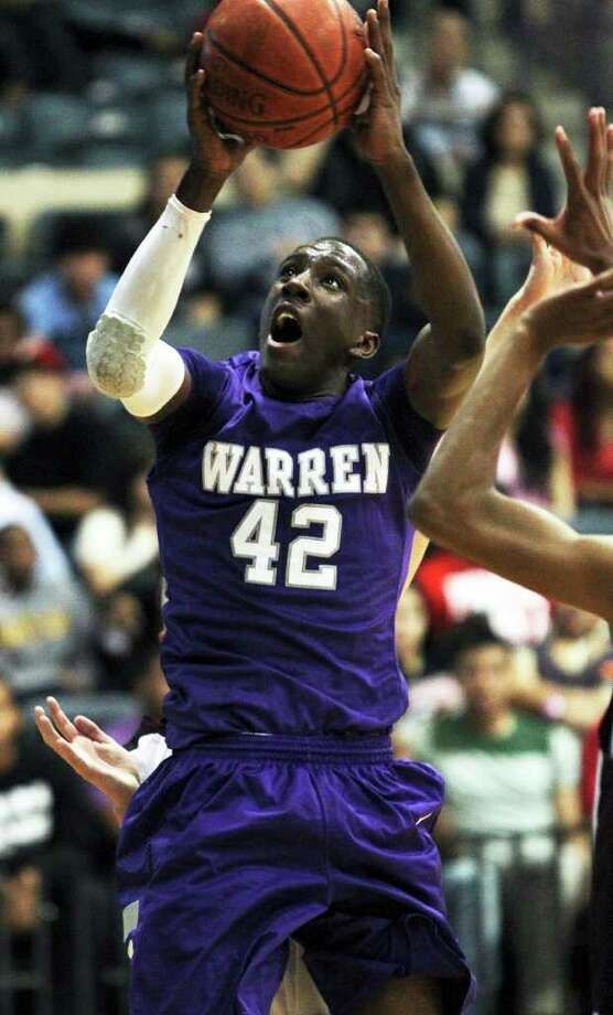 Warren forward Taurean Waller-Prince gets off a shot under the basket against Highlands in  February. Waller-Prince committed to Long Island University on Saturday, Warriors coach Jim Weaver said. Photo: Tom Reel/treel@express-news.net / © 2011 San Antonio Express-News