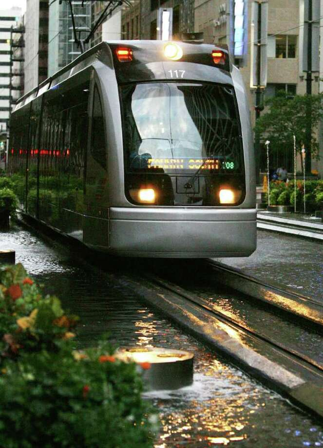 The Metro rail line on Main Street in downtown Houston Photo: Billy Smith Ii, Houston Chronicle / Houston Chronicle