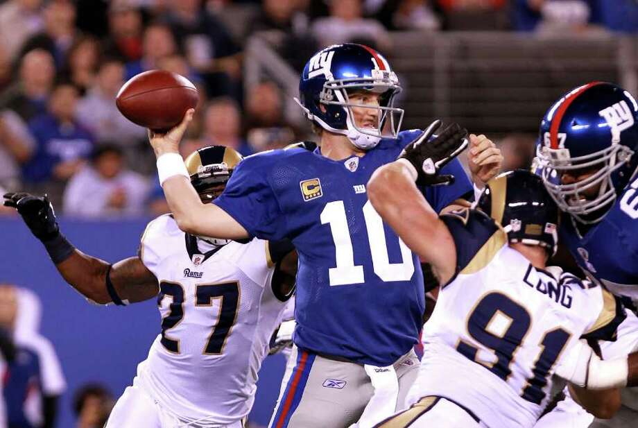 Sept. 19: Giants 28, Rams 16. Eli Manning threw two touchdown passes and linebacker Michael Boley scored on a 65-yard fumble return to lead New York to a 28-16 victory over the mistake-prone Rams Photo: Nick Laham, Getty Images / 2011 Getty Images