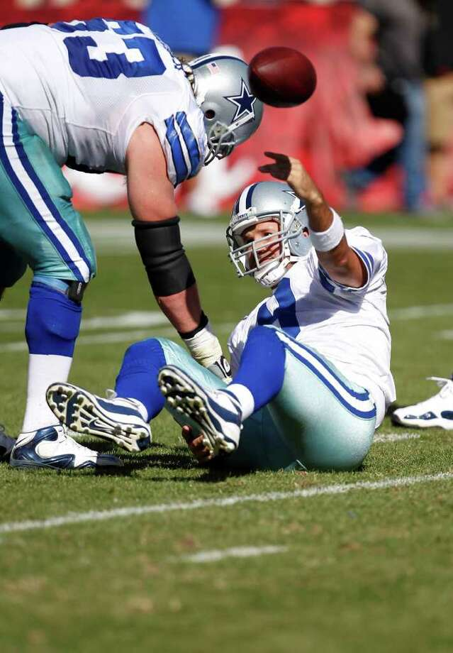 Dallas Cowboys' quarterback Tony Romo (9) is helped up by guard Kyle Kosier (63) against the San Francisco  49ers in an NFL football game in San Francisco,  Sunday,  Sept. 18,   2011. Photo: Tony Avelar, Associated Press
