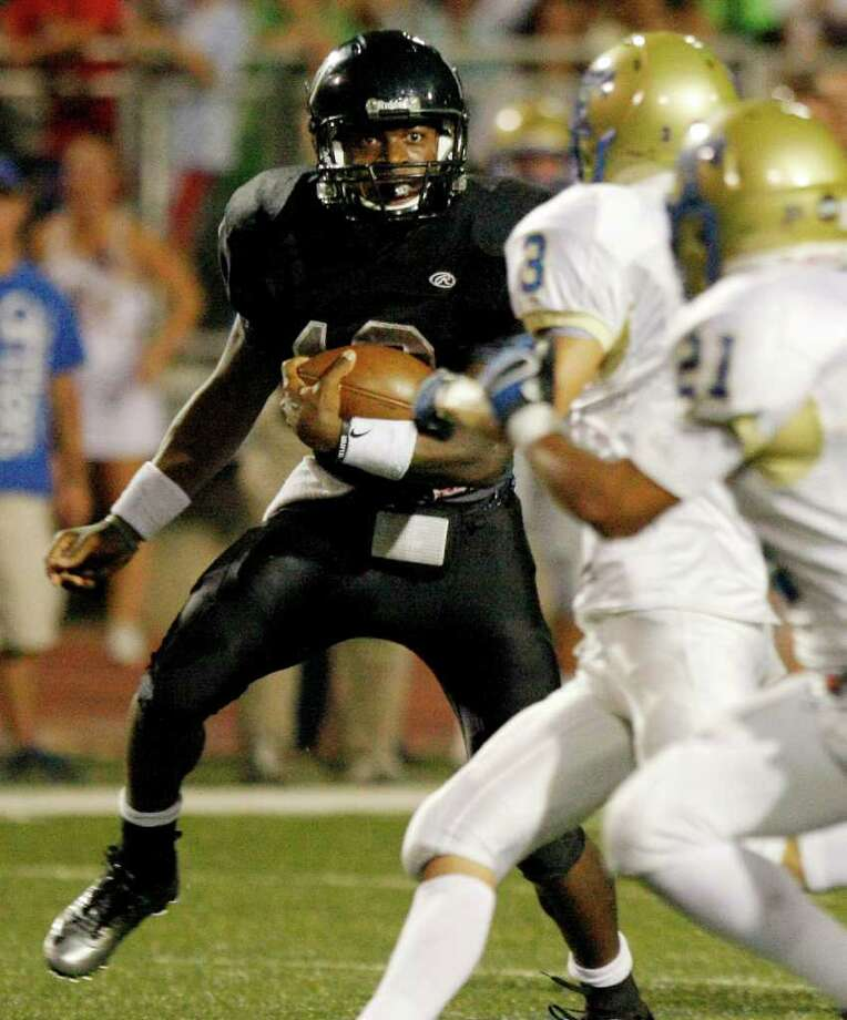 Steele QB Tommy Armstrong (left), looking for running room against Kerrville Tivy, said a close relationship with Nebraska offensive coordinator Tim Beck helped him decide. Photo: Darren Abate/Special To The Express-News