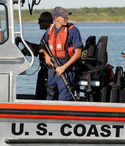 U.S. Coast Guard patrols on Falcon Lake, a lake that straddles the U.S. Mexico border, where where Coloradan David Hartley is still missing, Thursday, Oct. 7, 2010 in Zapata, Texas. Hartley's wife says he was shot to death by Mexican pirates chasing them on speedboats across the lake on Sept. 30 as they returned on Jet Skis from a trip to photograph a historic Mexican church. Photo: AP