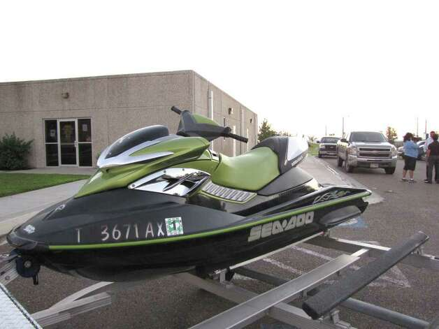 A personal watercraft that was used by a couple from McAllen on the waters of Falcon Lake near Zapata, Texas, Thursday afternoon Sept. 29, 2010 is parked outside the Zapata County Sheriff's office as evidence following an attack by armed suspects on the couple on the mexican side of the lake. Photo: CESAR RODRIGUEZ / LAREDO MORNING TIMES