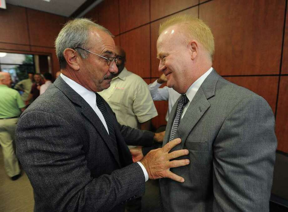 James Singletary, left, talks with retiring Police Chief Frank Coffin after Singletary was voted in as Beaumont's next police chief Aug. 30. Photo: Guiseppe Barranco