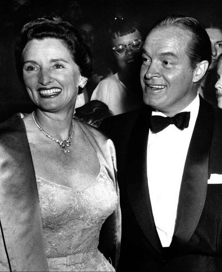 "FILE - In this 1955 file photo, entertainer Bob Hope, right, and his wife Dolores attend the premiere of Hope's movie ""The Seven Little Foys"" at a Paramount Theater in Los Angeles. Dolores Hope, who was married to Bob Hope for 69 years and sang at his shows, died Monday, Sept. 19, 2011 of natural causes at home in Los Angeles. She was 102. Photo: AP"