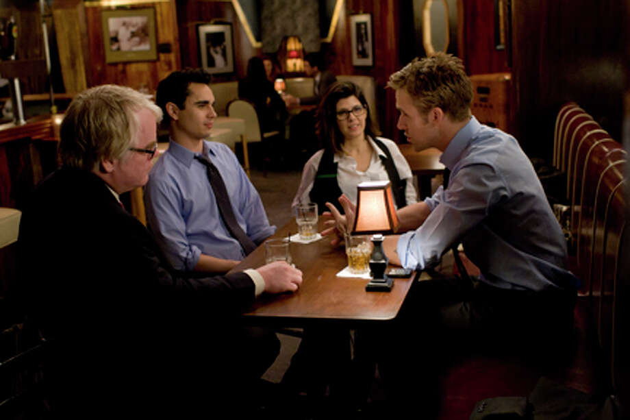 "(L-R) Philip Seymour Hoffman as Paul Zara, Max Minghella as Ben Harper, Marisa Tomei as Ida Horowicz and Ryan Gosling as Stephen Myers in ""The Ides of March."""