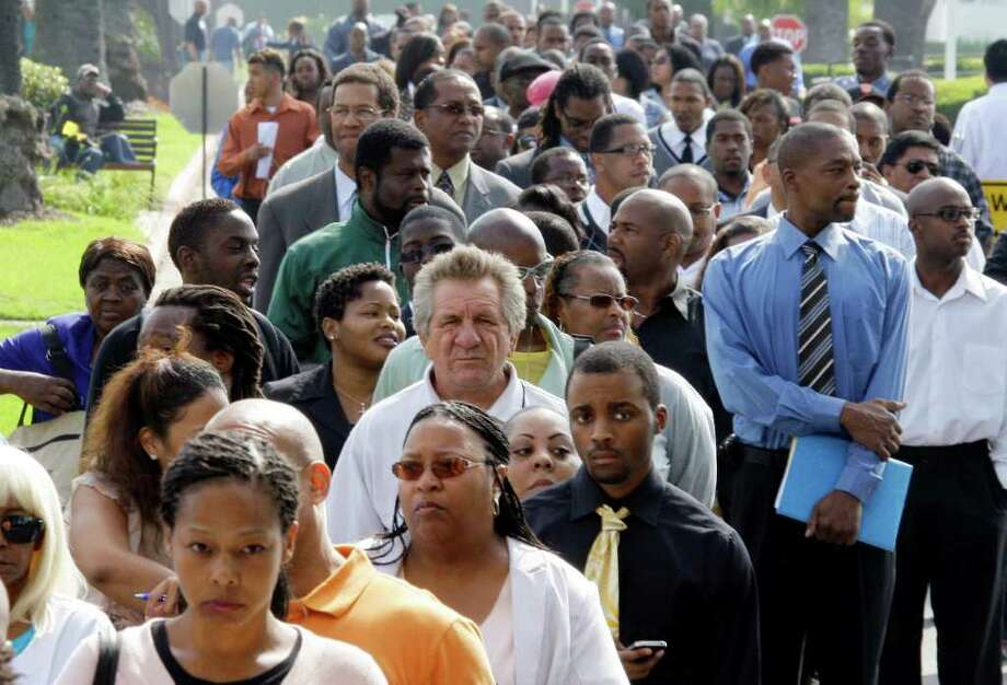 REED SAXON : ASSOCIATED PRESS WEAK RECOVERY: Job seekers wait to enter a job fair in South Los Angeles last month. A slower economy means high unemployment is likely to persist. Photo: Reed Saxon / AP2011