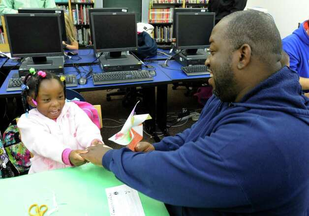 Keith Barnes builds a pinwheel Tuesday with his daughter Tanaya, 5, at the Delaware Community School in Albany. (Skip Dickstein / Times Union) Photo: Paul Grondahl / 00014694A