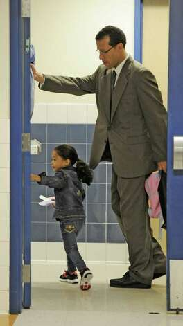 Andres Rivera with his daughter La'Vaye enter the Delaware Community School in Albany, N.Y. September 20, 2011, during a program to get father figures more involved with their children.  The Albany School District is joining with schools statewide in the event, a partnership with the New York State Fatherhood Initiative of the State Office of Children and Faily Services and Office of Temporary and Disability Assistance. (Skip Dickstein/Times Union) Photo: Paul Grondahl / 00014694A