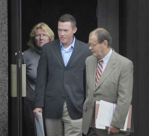 James Kiernan, center, from Queens leaves Albany City Court with his attorney James Long, right, and his mother following a hearing on his case pertaining to the kegs and eggs riot that took place in Albany.  Kiernan was seen in the videos of the riot as playing the bag pipes on top of the hood of a car.   Kiernan was sentenced to 250 hours of community service and $995.66 in restitution. (Paul Buckowski / Times Union) Photo: Paul Buckowski  / 00014698A