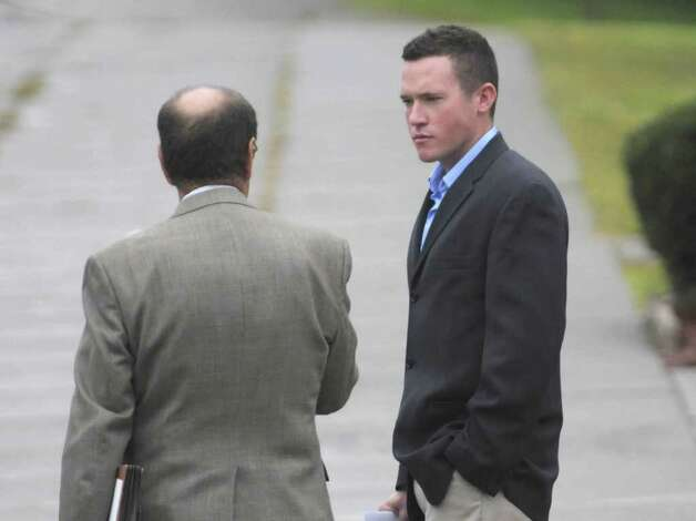 James Kiernan, right, from Queens leaves Albany City Court with his attorney James Long following a hearing on his case pertaining to the kegs and eggs riot that took place in Albany.  Kiernan was seen in the videos of the riot as playing the bag pipes on top of the hood of a car.   Kiernan was sentenced to 250 hours of community service and $995.66 in restitution. (Paul Buckowski / Times Union) Photo: Paul Buckowski  / 00014698A