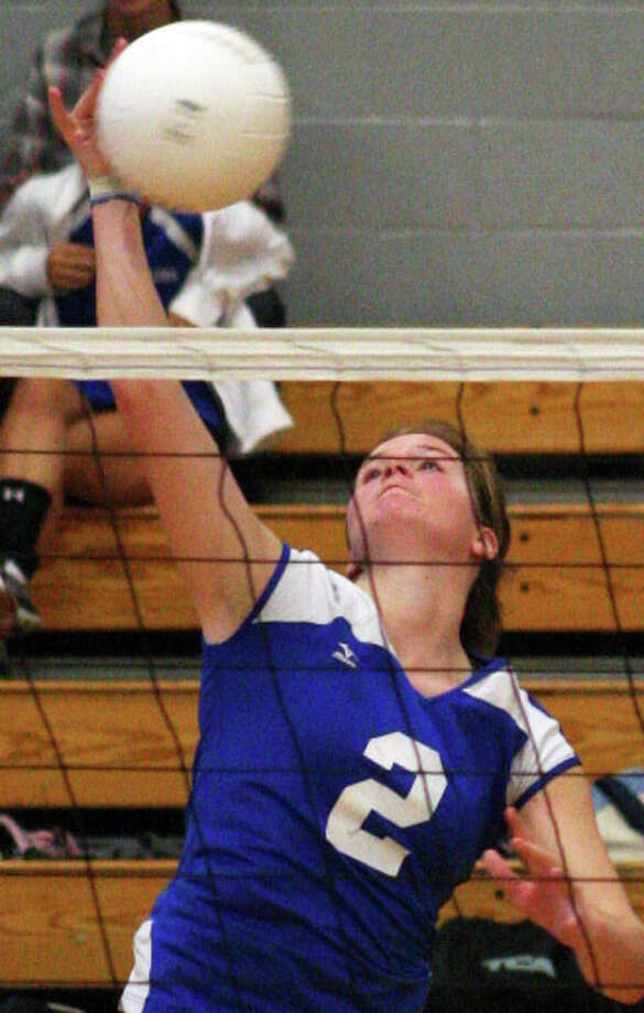 Ludlowe's Emily Nelson slams home a spike during the Falcons' 3-0 loss to Darien on Friday. Photo: Tim Parry