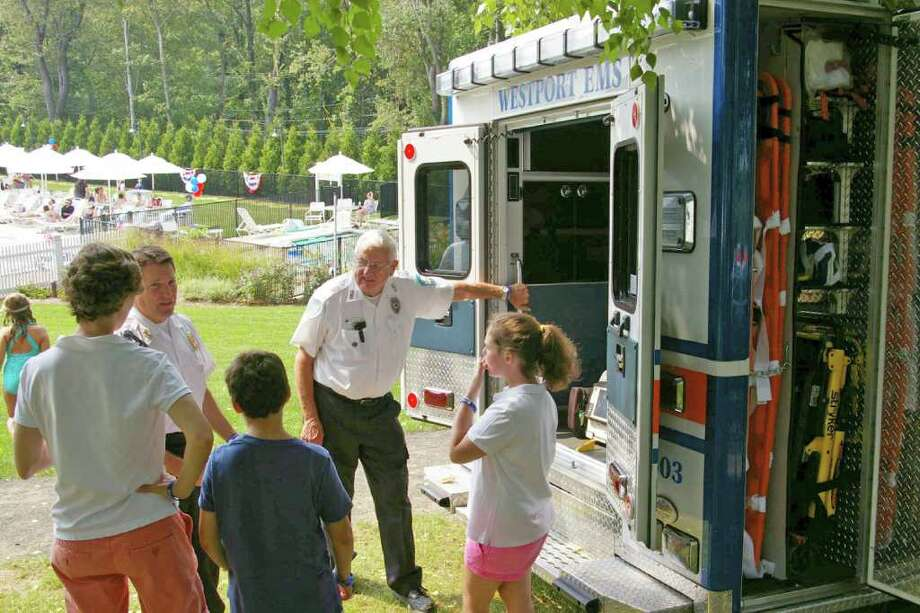 The Birchwood Country Club, located at 25 Kings Highway South, held a fundraising drive over Labor Day weekend to benefit Westport Volunteer EMS (WVEMS). In this photo, EMS Coordinator Marc Hartog and volunteer Russ Blair demonstrate and explain the equipment carried on ambulances to members of the Birchwood Country Club. Photo: Contributed Photo / Westport News contributed