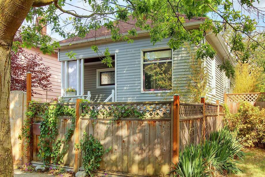 People increasingly want to buy smaller homes closer to jobs and shops, according to a new report by real-estate company Trulia. Here are a few such homes in central Seattle listed for less than $400,000, starting with this one at 110 26th Ave. S. The 1,660-square-foot house, built in 1904, has three bedrooms and 1.75 bathrooms, with French doors, wide moldings, dark-stained wood floors and a daylight basement, on a 2,600-square-foot lot. It's listed for $349,000. Photo: Coldwell Banker Bain