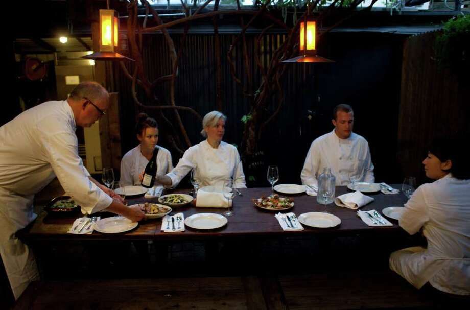 MIKE KEPKA : STAFF Family-style dinner: Alice Waters, of Chez Panisse, cobbled together much of her kitchen staff by pulling from her wide circle of talented, artistic friends. Photo: Mike Kepka / San Francisco Chron / ONLINE_YES