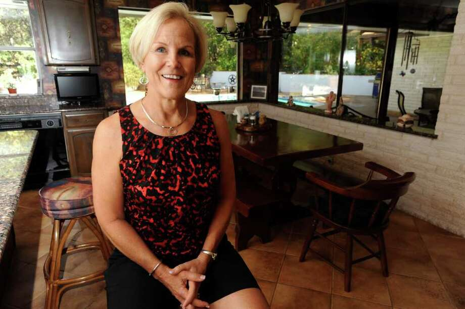 Karen Cannon loves the views from her kitchen in her Garden Ridge home that was built by her parents. Photo: BILLY CALZADA, SAN ANTONIO EXPRESS-NEWS / gcalzada@express-news.net