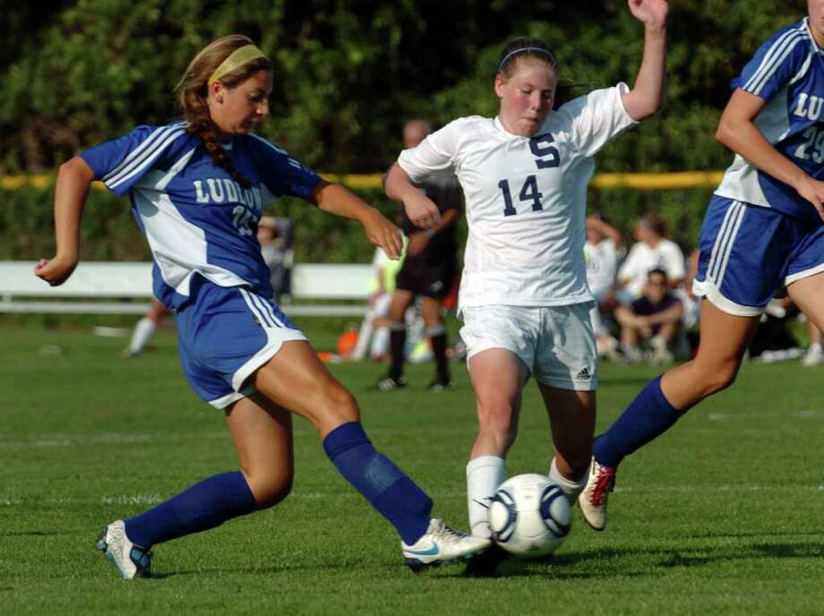 Staples freshman Chloe Rosenfield, No. 14, and Fairfield Ludlowe's Alison Gorab, No. 19, converge on the ball Sept. 13. Rosenfield has stepped up as a rookie midfielder for the Lady Wreckers and impressed her coach Monday in a 4-0 loss at Danbury. Photo: Christian Abraham / Staff Photographer
