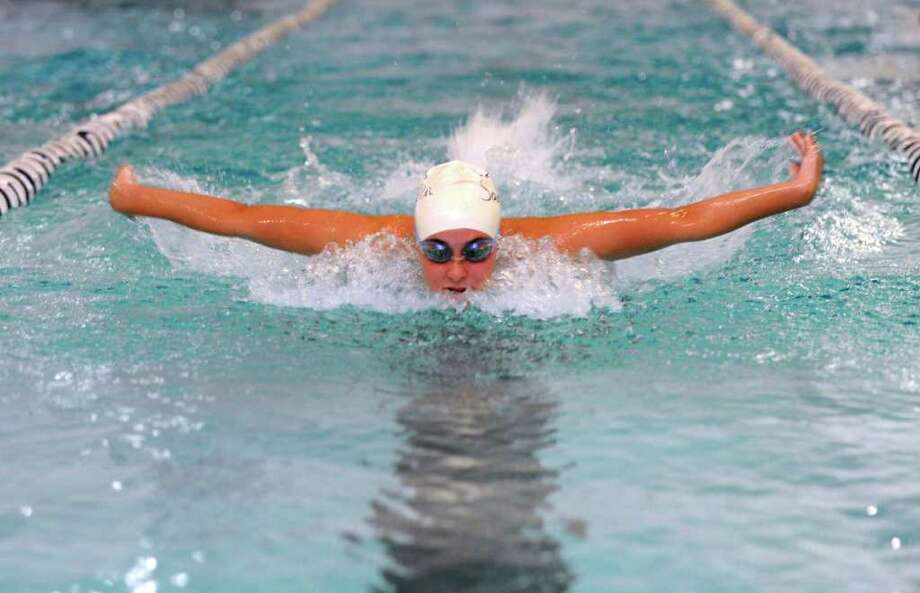 Staples freshman Jordan Santarella works on her form during the preseason. Santarella's practice paid off as she contributed to the Lady Wreckers' win at East Lyme Friday in her varsity debut by placing second in the 200-yard individual medley and 100-yard butterfly and swam the second leg for the victorious 400-yard freestyle relay team. Photo: Autumn Driscoll / Staff Photographer