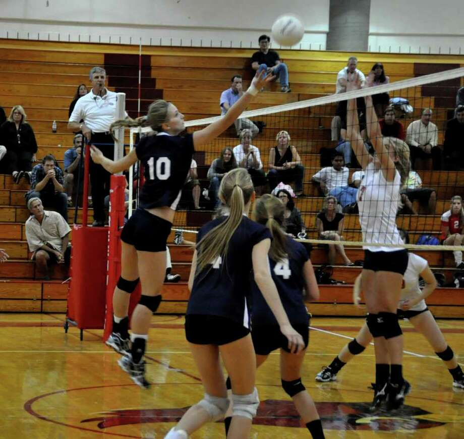 Augustine Gradoux-Matt tips it over for Staples Friday at Greenwich. Gradoux-Matt was a force at the net with six kills in the Lady Wreckers' 3-0 victory. Photo: Suzanne Kalb / Contributed Photo