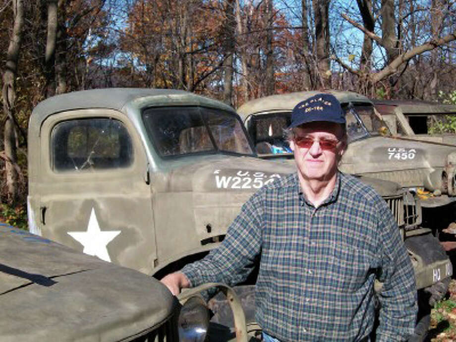 Bruce Bird, curator of the Museum of Black World War II History, with U.S. Army vehicles at the museum's current location in Vermont. The museum is considering moving to Stamford. Photo: Contributed Photo